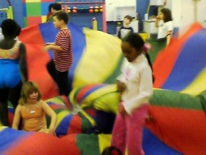 Children Play in a Toy Parachute